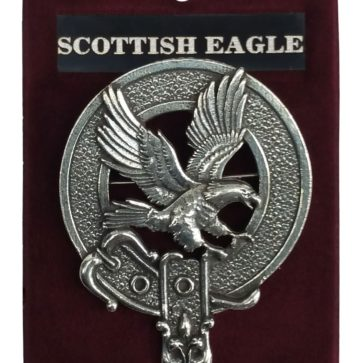 A Scottish Eagle in flight circled by the belt and buckle of a clan badge.