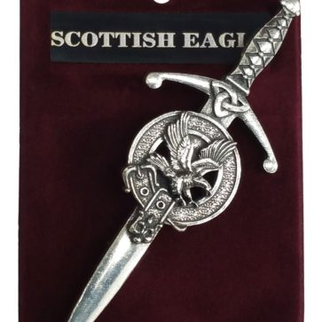 A sword shaped kilt pin with an eagle by the hilt.