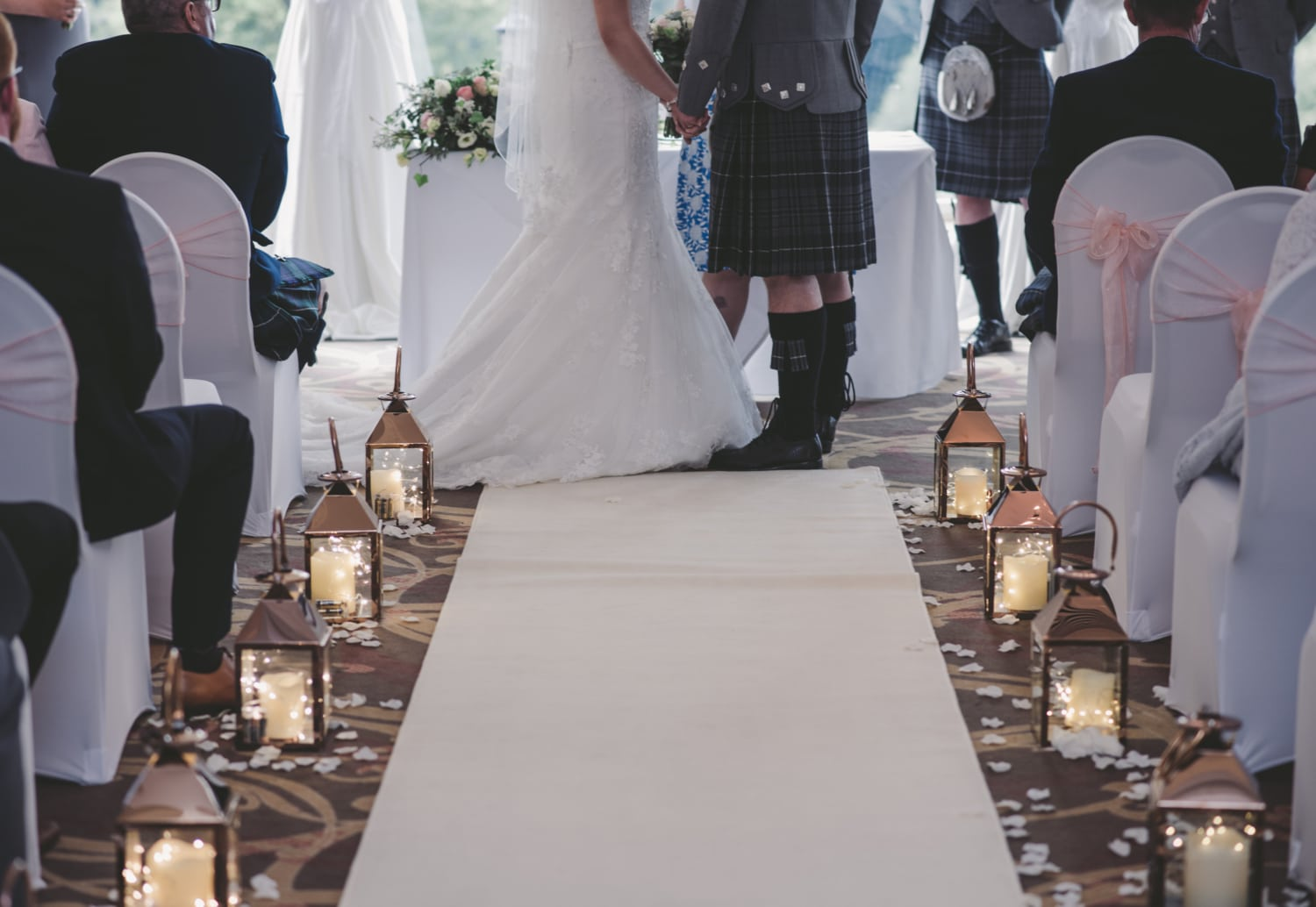 A bride and groom getting married at a Scottish wedding