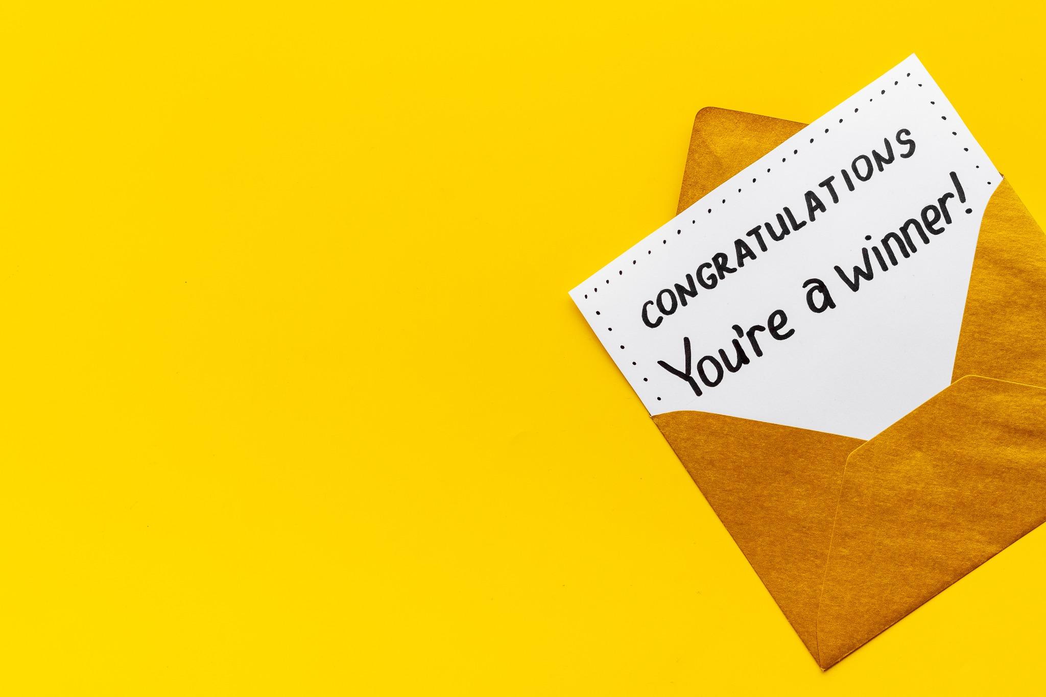 """A card that says congratulations, symbolizing the Welsh word """"Llongyfarchiadau""""!"""