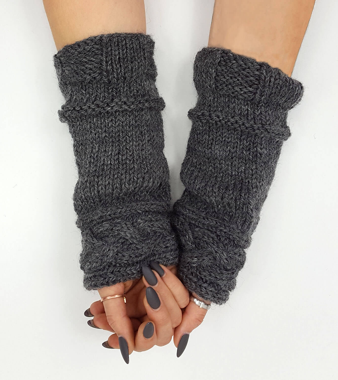 "These 100% wool wrist warmers are lovingly hand-knit in the USA. Inspired by the arm cuffs that Claire wears in OUTLANDER: The series. Wear it for your love of OUTLANDER or just for warmth and style. Measures approximately 4.5"" x 9"""