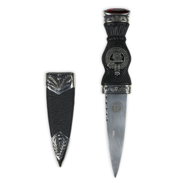 knife with black handle and sheath