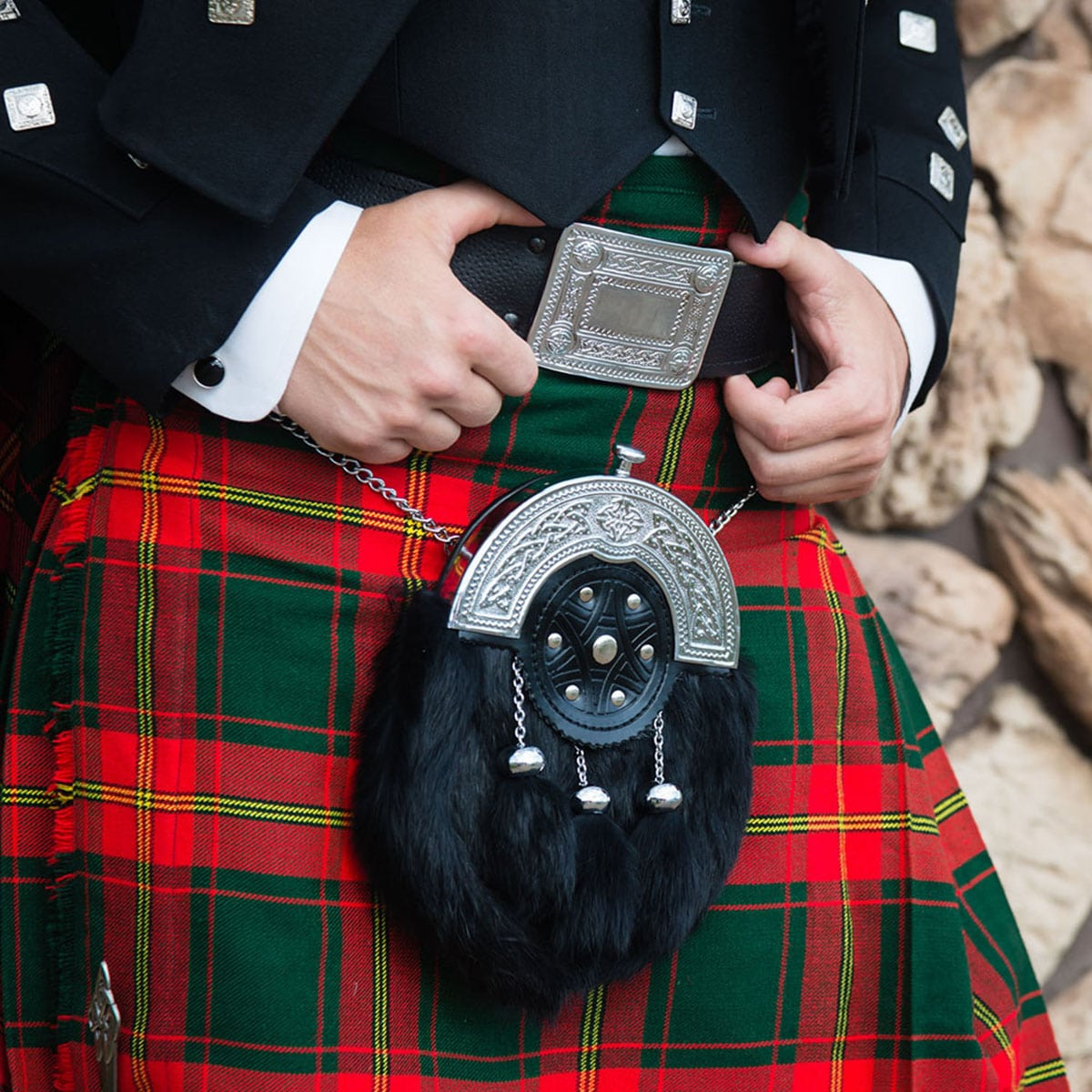 A belt and buckle worn with a wedding kilt and sporran