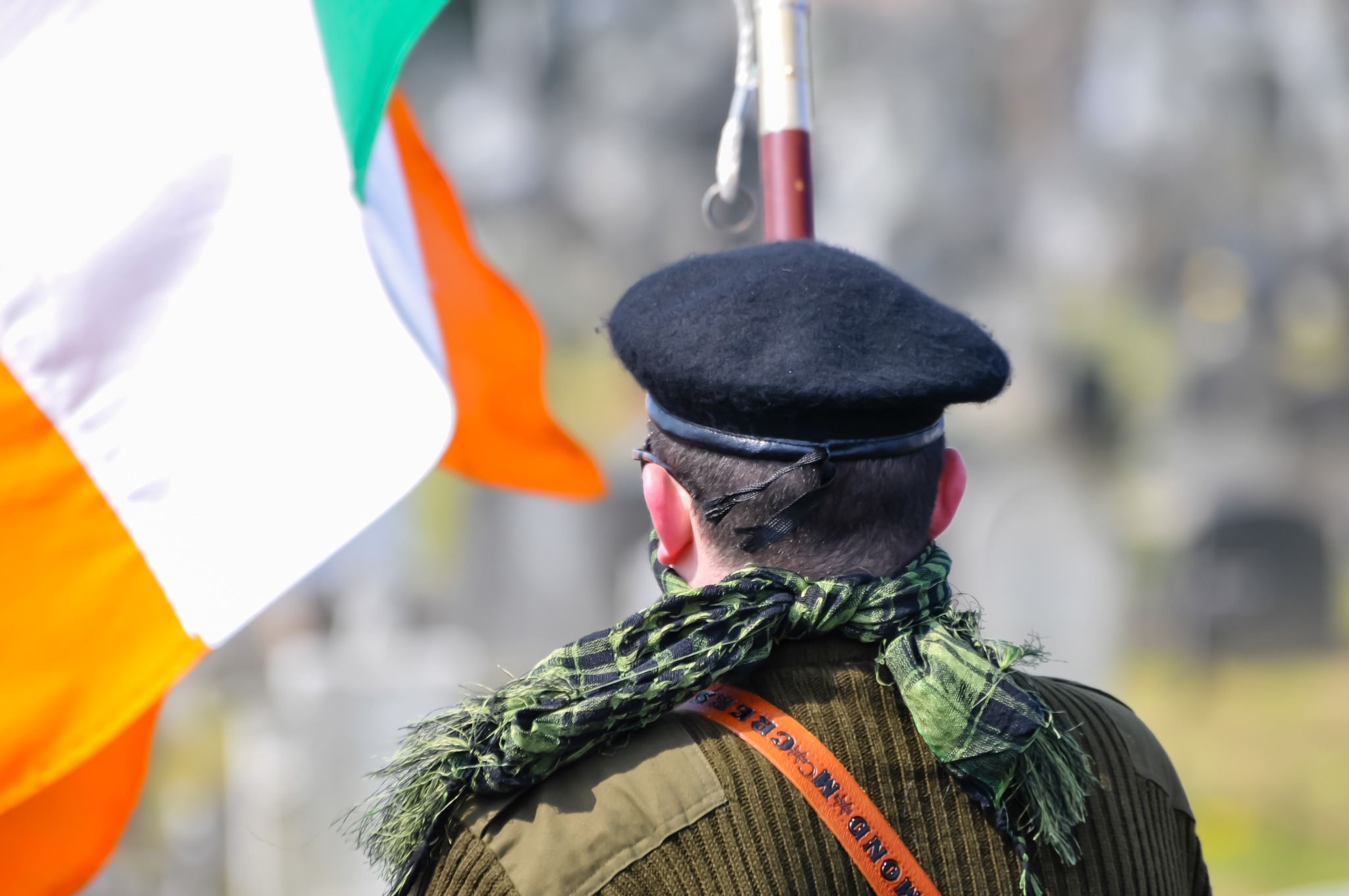 A man waving the Irish flag to commemorate the Easter rising of 1916