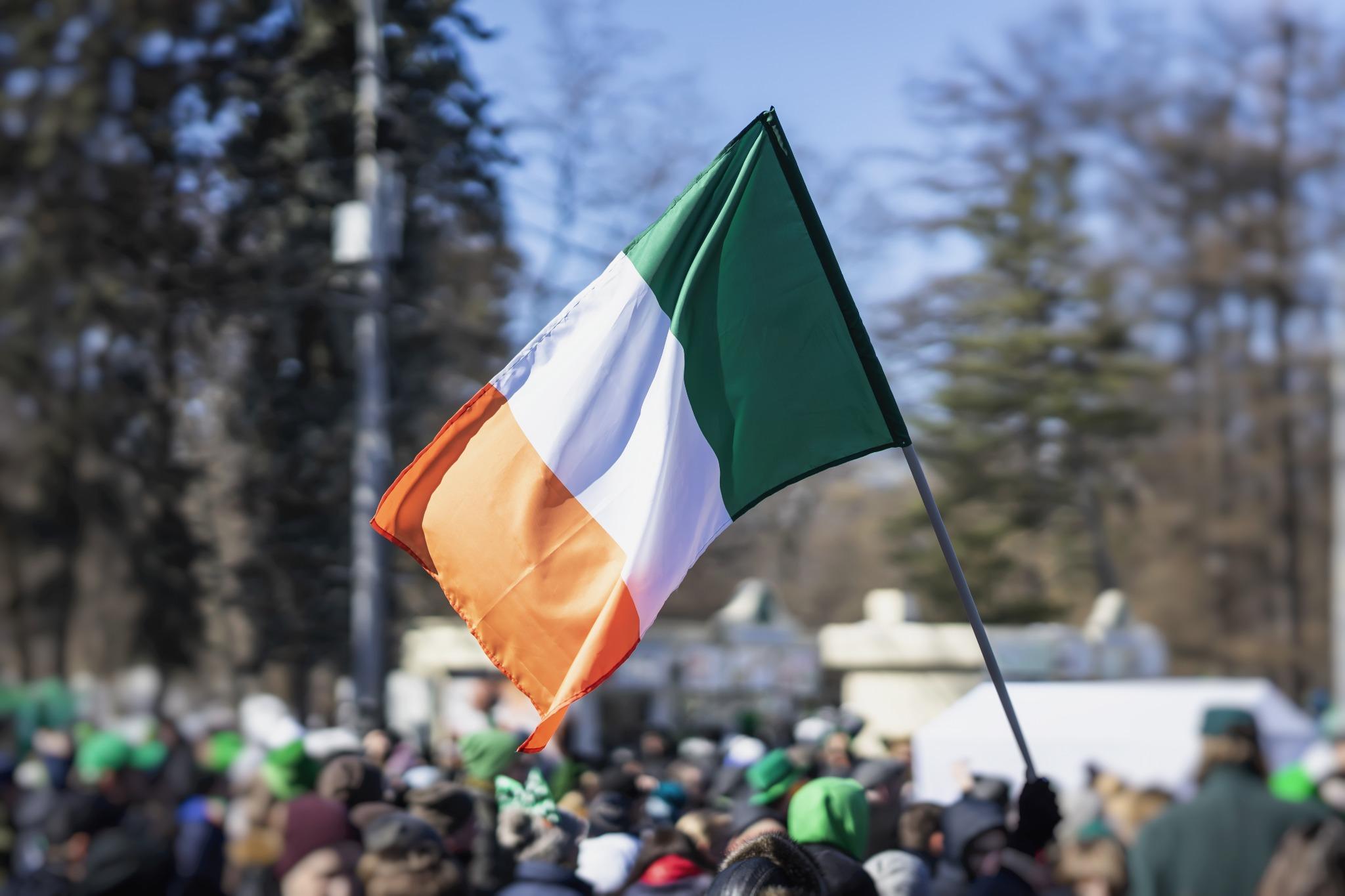 An Irish flag at a St. Patrick's Day parade.
