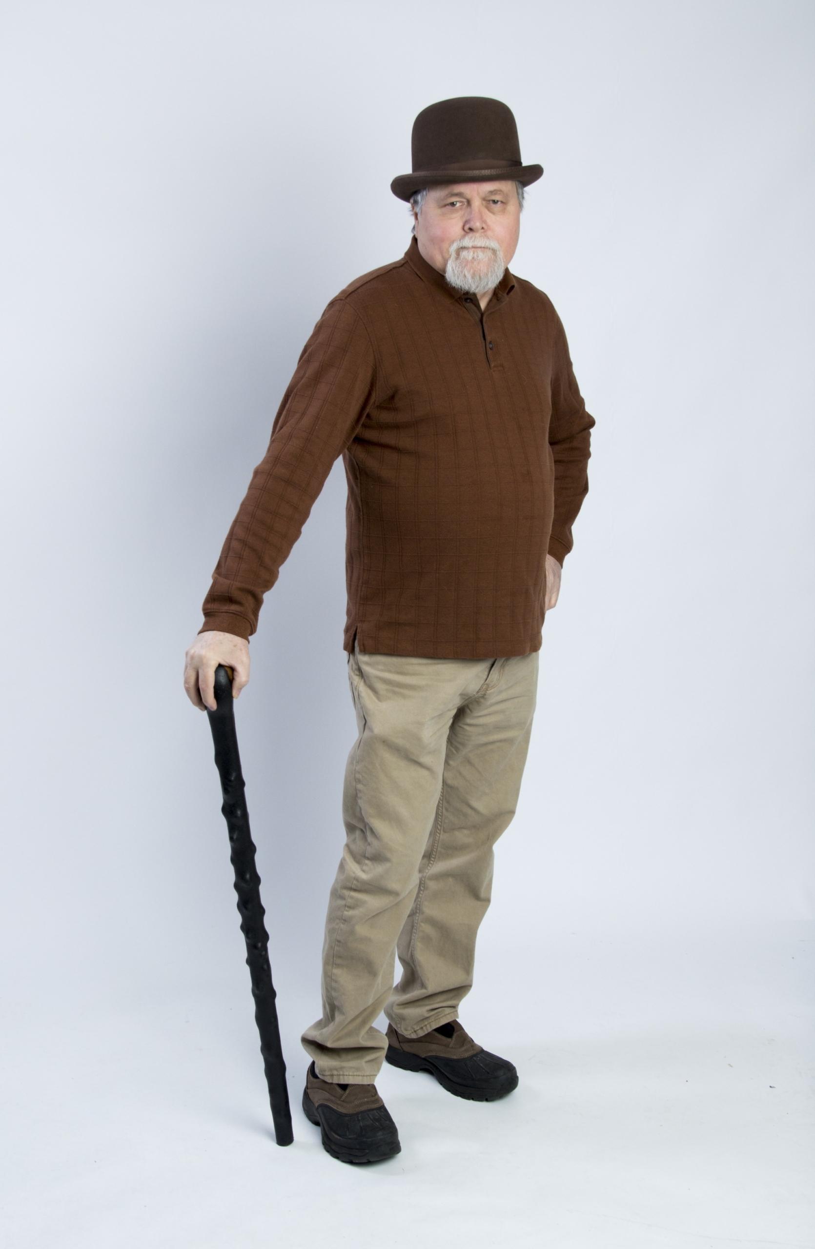A man using a Shillelagh as a walking stick,a nd not for Irish stick fighting