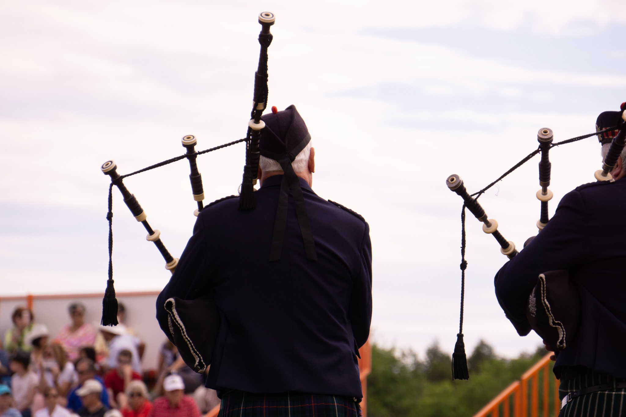 Gentlemen playing bagpipes at a modern event.