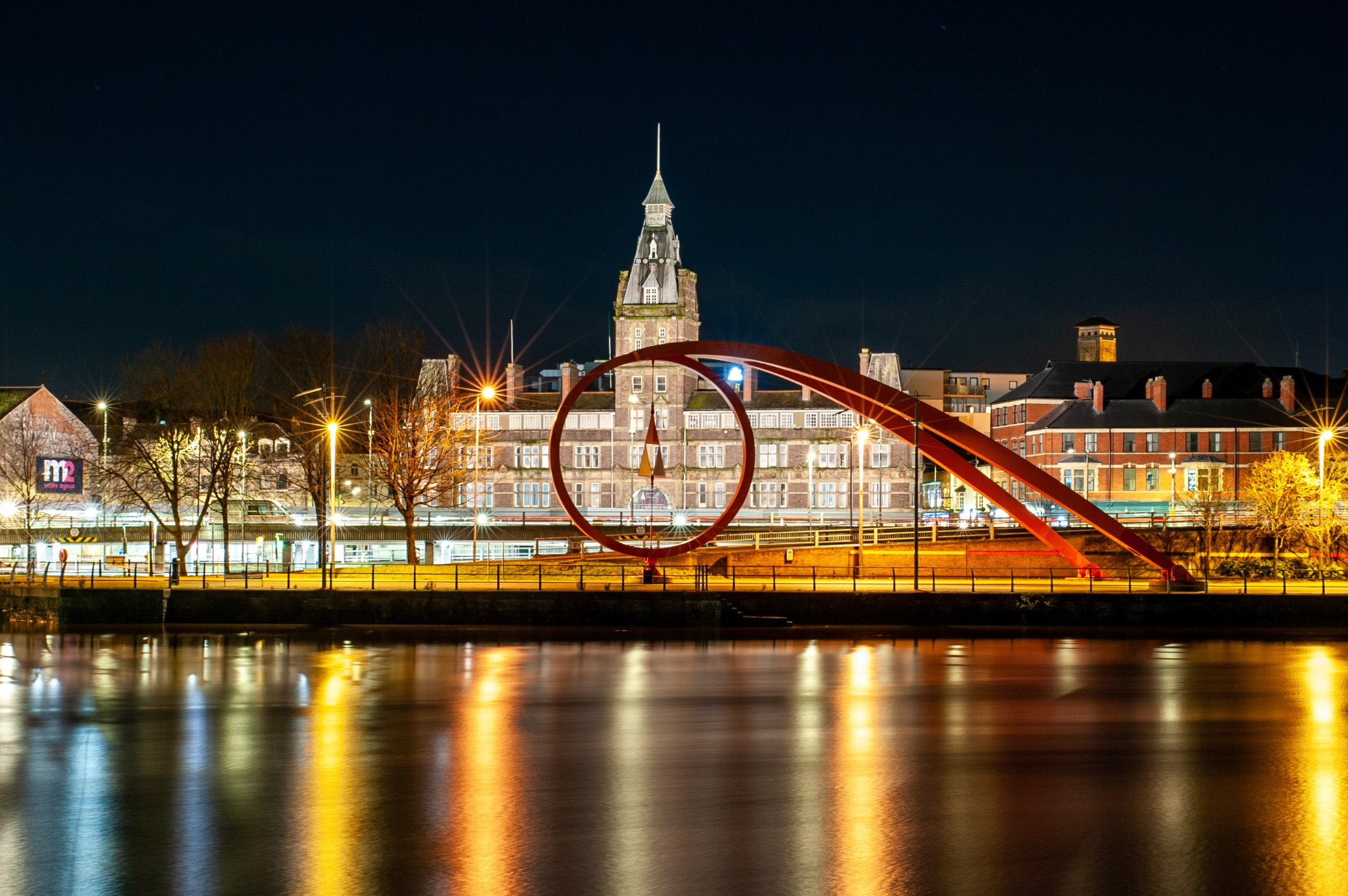 Newport, Wales cityscape at nighttime.