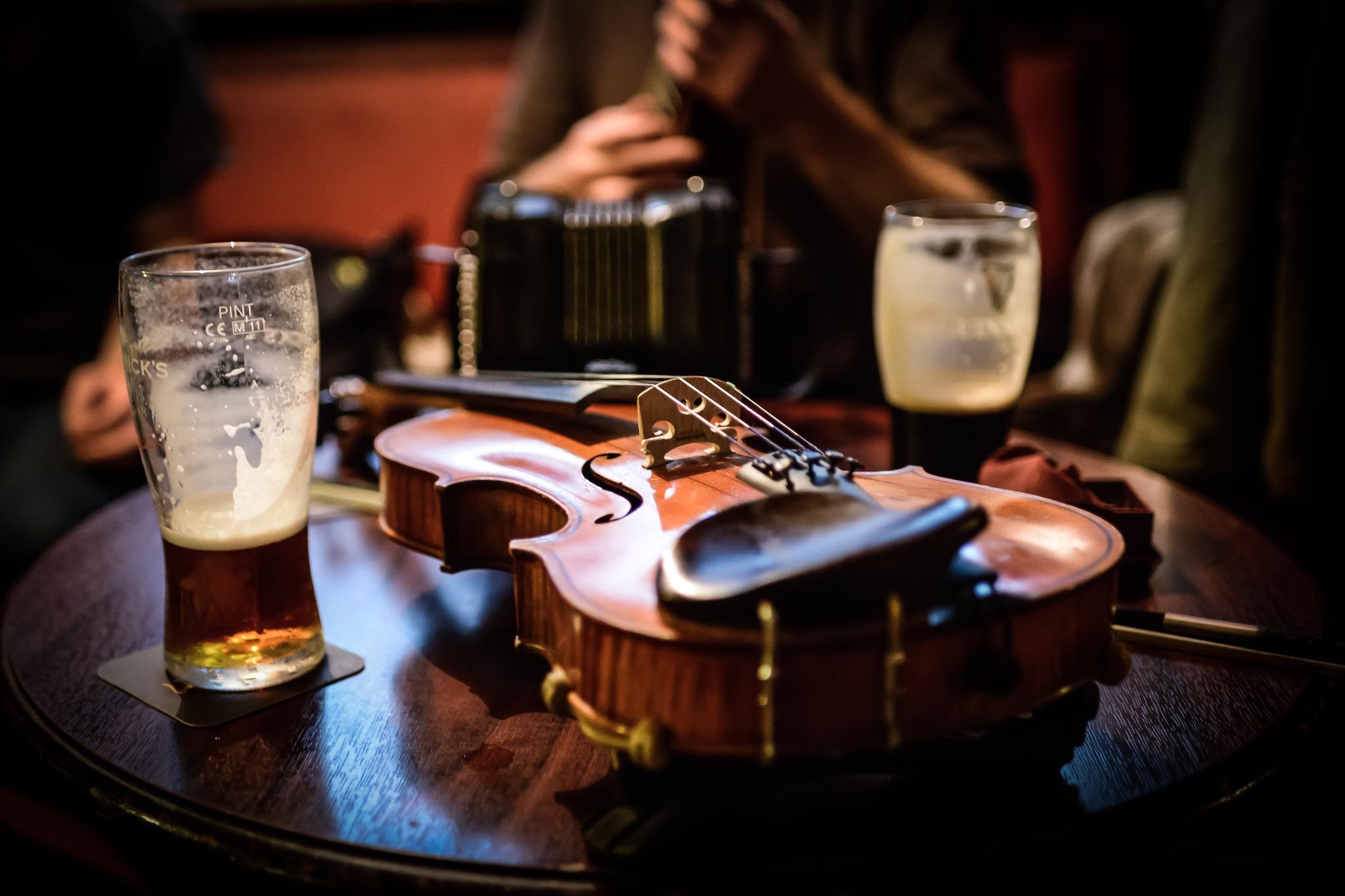 A violin on a table at an Irish pub.
