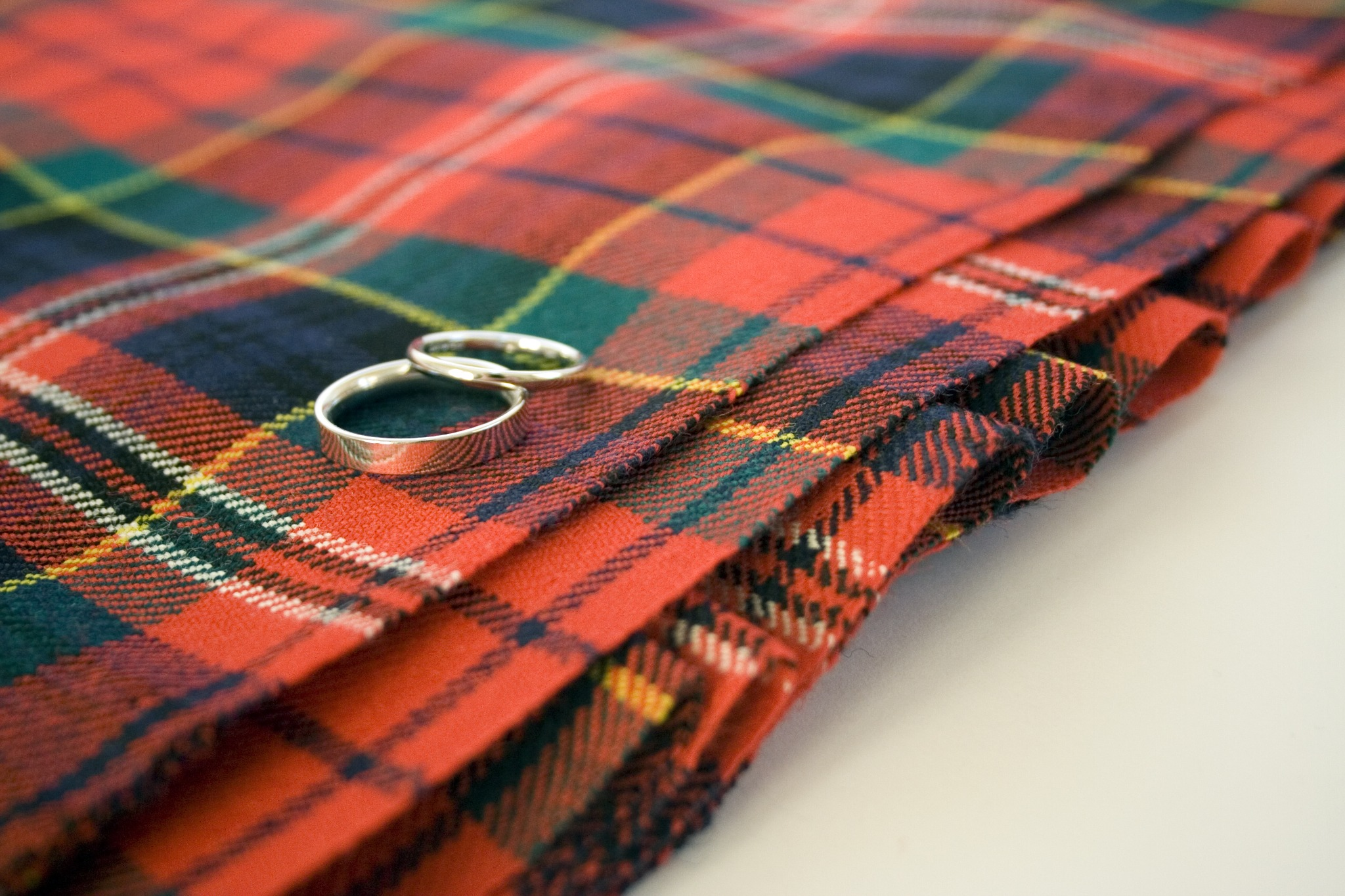 Wedding rings on a piece of red tartan