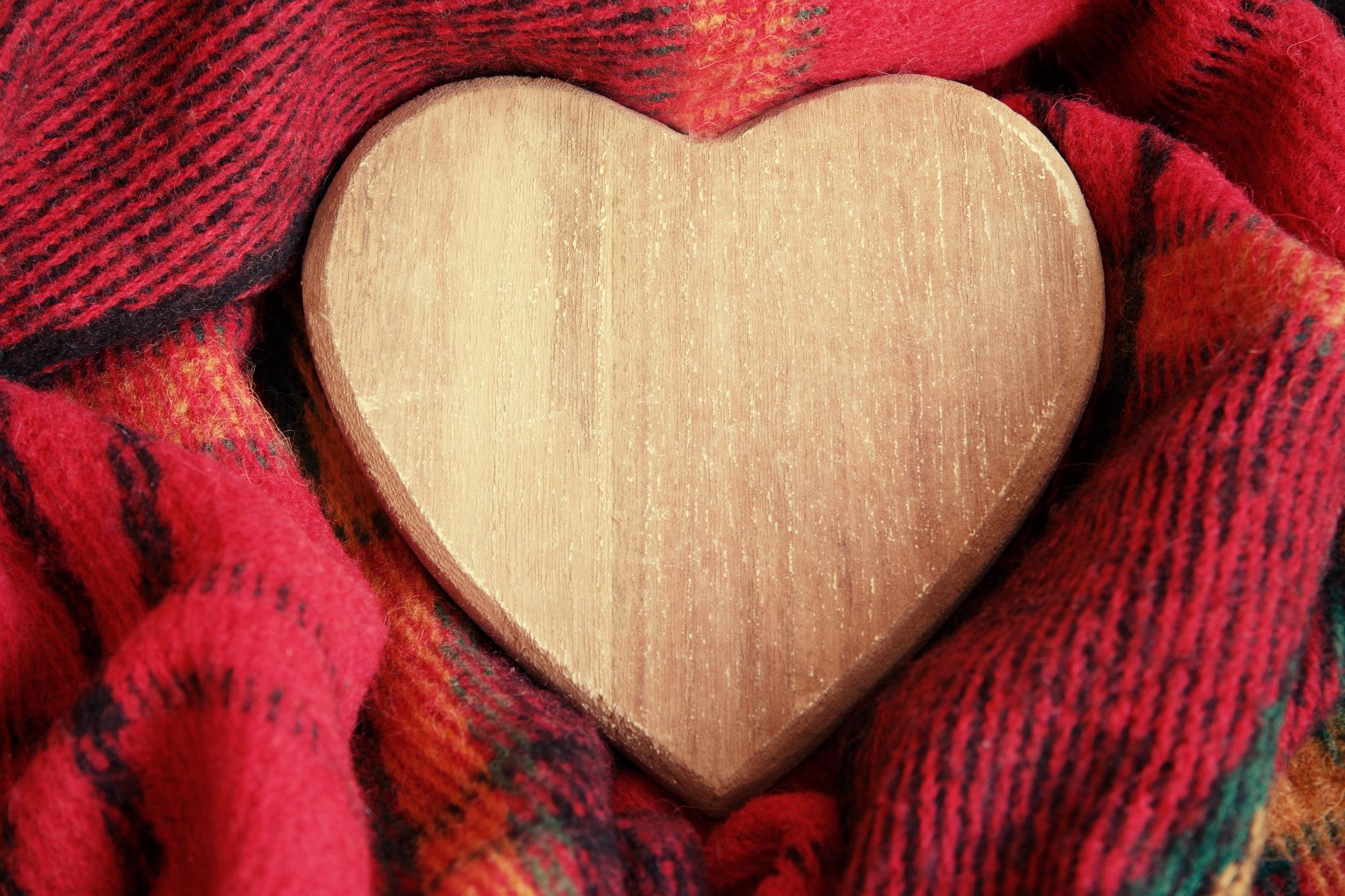 A wooden heart wrapped in tartan